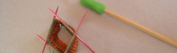 Can't knit on short needles because you knit with a needle under one arm?